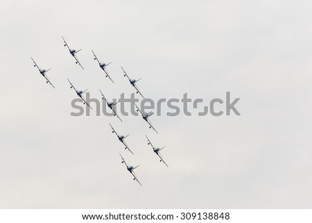 "RADOM, POLAND - AUGUST 23: Aerobatic group formation ""Frecce Tricolori""  italian aerobatic Team at blue sky during Air Show Radom 2015 event on August 23, 2015 in Radom, Poland"