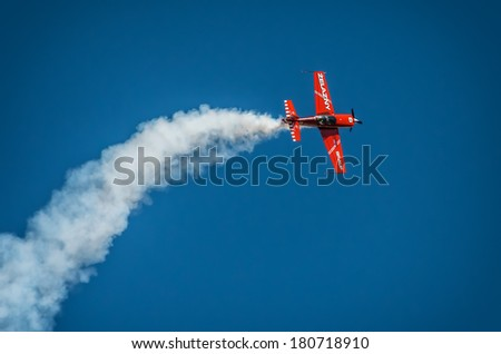 "RADOM, POLAND - AUGUST 25: Aerobatic group formation ""Zelazny"" at blue sky during Air Show 2013 event on August 25, 2013 in Radom, Poland"