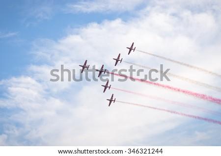 RADOM, POLAND - AUGUST 23, 2015: Display of polish team Bialo-czerwone Iskry. Airshow event on 23 August 2015, Radom, Poland  - stock photo