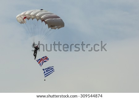 RADOM, POLAND - AUGUST 23: Parachutist with the diferent flags at Air Show Radom 2015 event on August 23, 2015 in Radom, Poland
