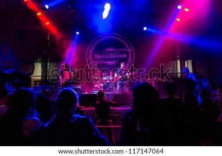 "RADZIONKOW, POLAND - SEPTEMBER 02: The show of Ash'n'beher band during StreetART festival"". September  02, 2012 in Radzionkow,(Silesia province), Poland. - stock photo"