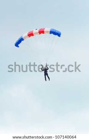 RAF COSFORD, SHROPSHIRE, ENGLAND - JUNE 17: Unidentified RAF Falcons parachute display team member displaying his directional control skills on June 17, 2012 at RAF Cosford, Shropshire, England.