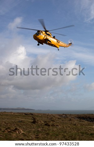 RAF Seaking search and rescue exercise winching off cliffs on the Isle of Anglesey North Wales