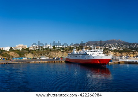 Rafina port with anchored ship against a blue sky and blue waters in Evia, Greece - stock photo