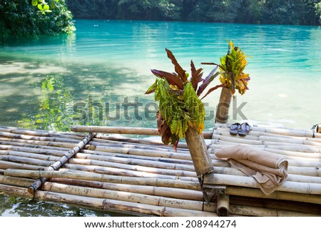 Raft on the bank of the Blue lagoon, Jamaica  - stock photo