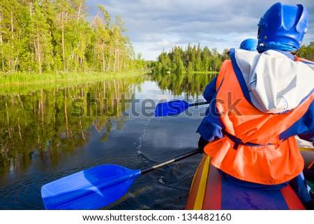 Rafters in a rafting boat on Pistojoki river in Karelia, Russia - stock photo