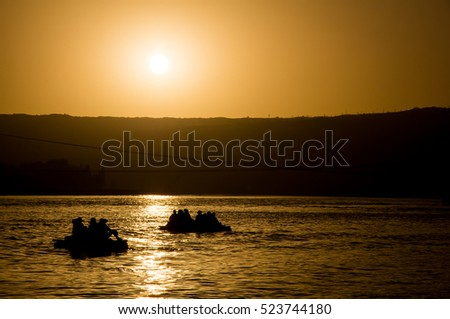 Rafting during sunset, Yellow River, Shapotoou, China