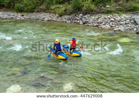 Rafting on a catamaran on the mountain river  - stock photo