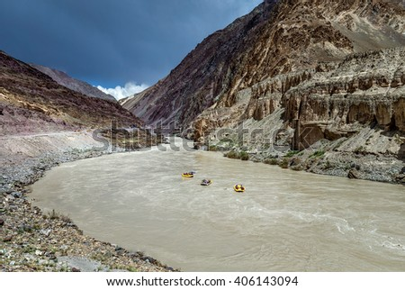 Rafting on the Zanskar river near the confluence of the Indus and Zanskar river - Tibet, Leh district, Western Ladakh, Himalayas, Jammu and Kashmir, Northern India.   - stock photo