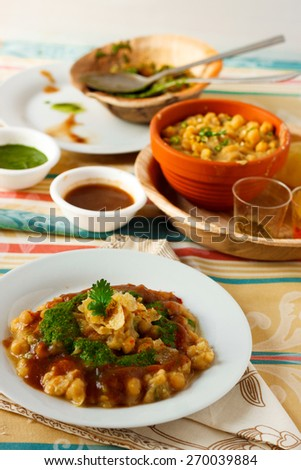 Ragda Pattice , Chat A street food from India. A potato patty is placed on a bed of dried peas gravy, topped up with chutneys, spice powdershand crushed pieces of crisps & coriander leaves - stock photo