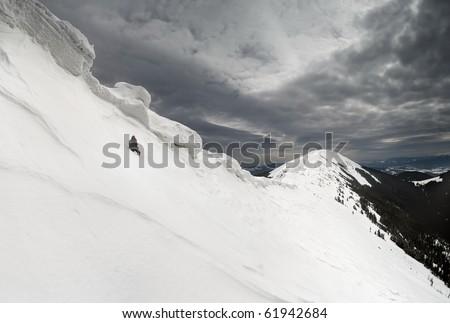 rage photographer under the snow cornices - stock photo