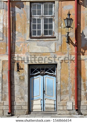 Ragged wall of an old building - stock photo