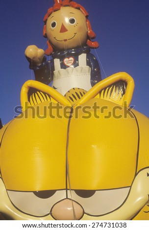 Raggedy Ann and Garfield Balloon in Macy's Thanksgiving Day Parade, New York City, New York - stock photo