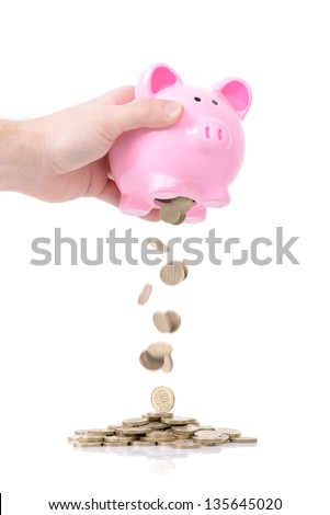 raiding the piggy bank for a rainy day isolated on white - stock photo