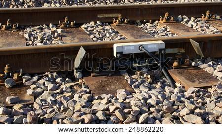 Rail brakes on the siding tracks in sunny day - stock photo