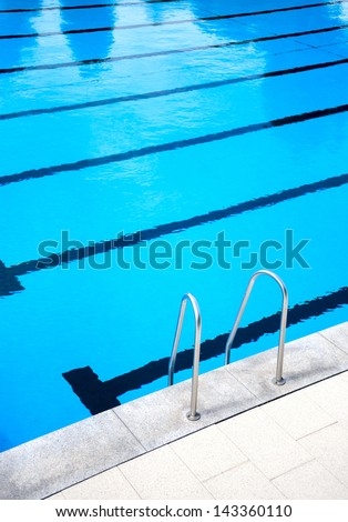 Rail in the outdoors swimming pool - stock photo