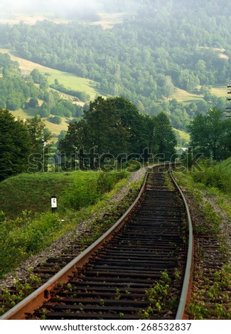 Rail path in the mountains on a background of mountain hills and forests