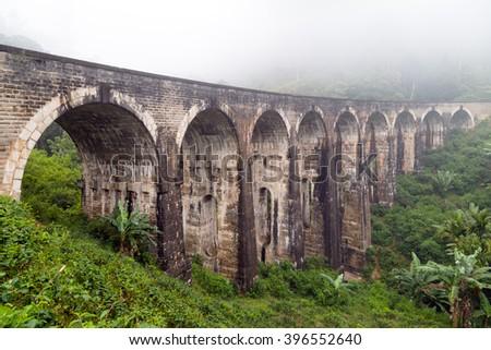 Rail road bridge Demodara Nine Arch Bridge morning mist, Gotuwala, Ella, Sri Lanka - stock photo
