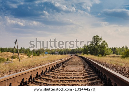 Rail tracks disappearing in the distance, low angle, near focus. Railway details.