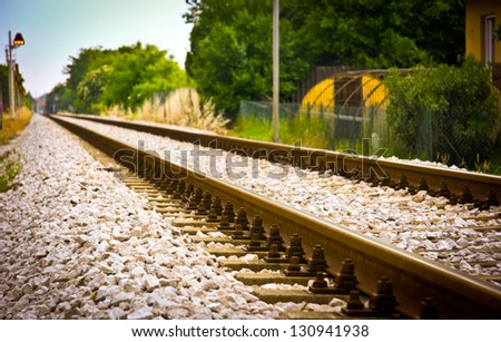 Rail tracks disappearing in the distance, low angle, near focus, Udine, Italy - stock photo