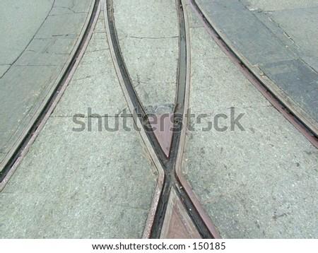 Rail tracks in road - stock photo