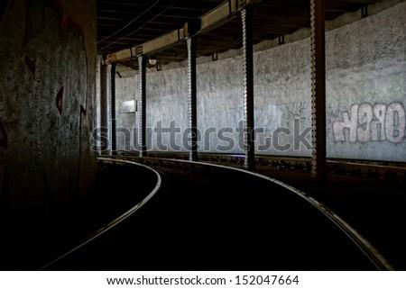 rail tunnel with graffiti - stock photo
