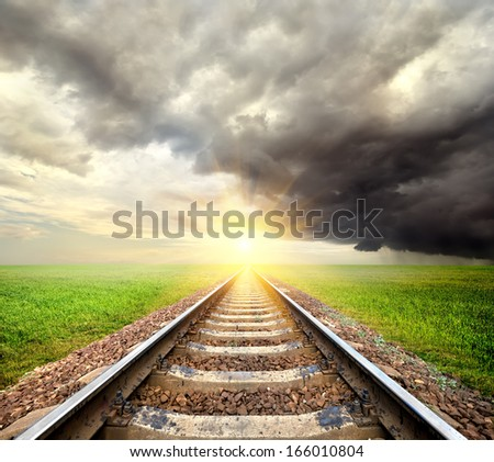 Railroad and clouds in the field at sunrise