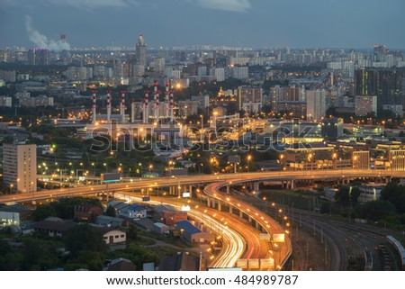 Railroad and modern highway at summer cloudy night in Moscow, Russia, long exposure