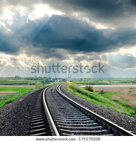railroad and rainy clouds over it