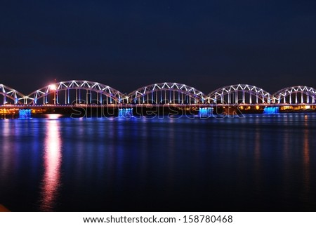 Railroad bridge in Riga by night - stock photo