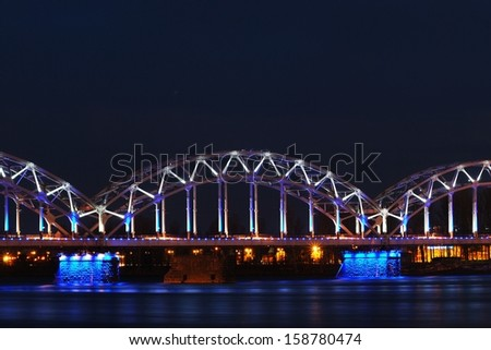 Railroad bridge in Riga by night - stock photo