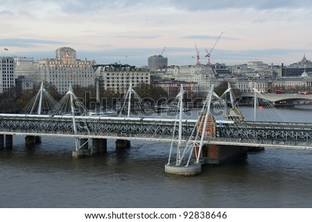 Railroad bridge over Thames to Charing Cross station - stock photo