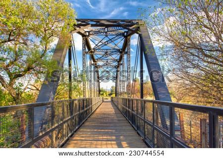 Railroad bridge over the Iron Horse Trailhead in Santa Clarita, California - stock photo