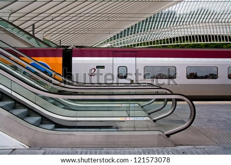 Railroad car behind escalators - stock photo