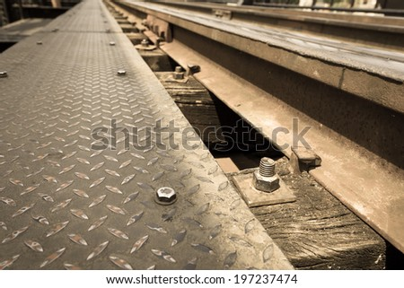 Railroad construction using nuts as a placeholder.