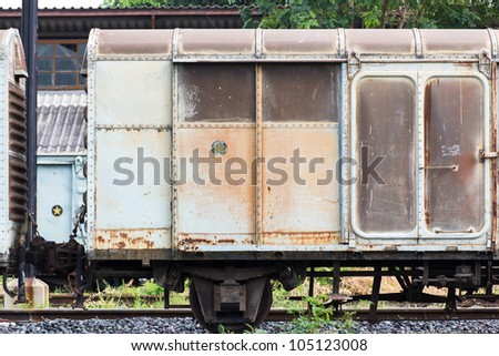Railroad container doors with more rusty old - stock photo