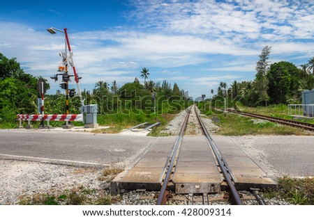 Railroad crossing - An intersection between road and railroad tracks.it's dangerous - stock photo
