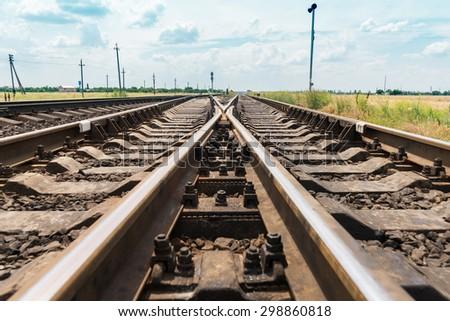 railroad crossing closeup - stock photo