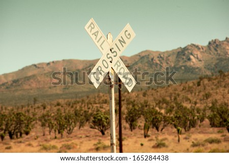 Railroad crossing sign in the desert - stock photo