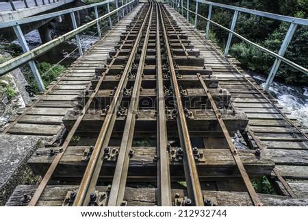 Railroad crossing. Vintage railway bridge - stock photo