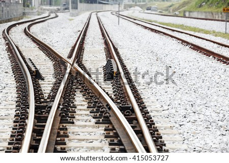 Railroad crossover tracks on a gravel bed.