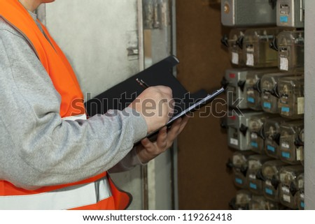 Railroad employee near the electrical (relay) enclosure - stock photo