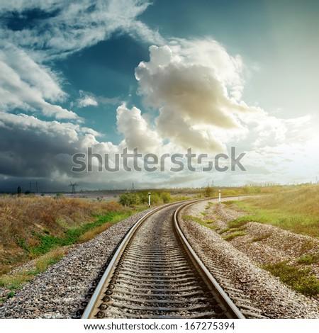 railroad goes to cloudy horizon - stock photo