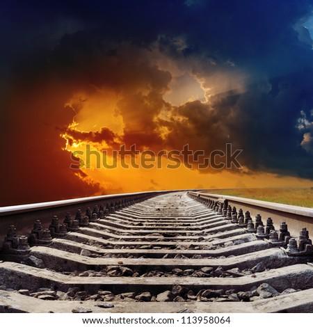 railroad goes to dramatic sunset - stock photo