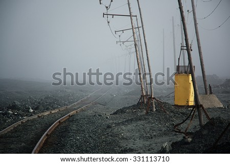 Railroad going into the fog