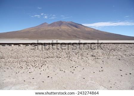 Railroad in Atacama Desert over mountain, Uyunu, Bolivia - stock photo