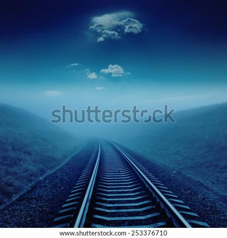 railroad in night under blue moonlight - stock photo