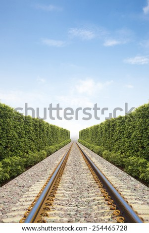 Railroad in the garden and blue sky - stock photo