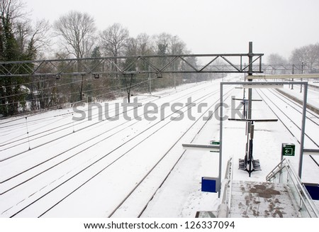 railroad in winter snow landscape - stock photo