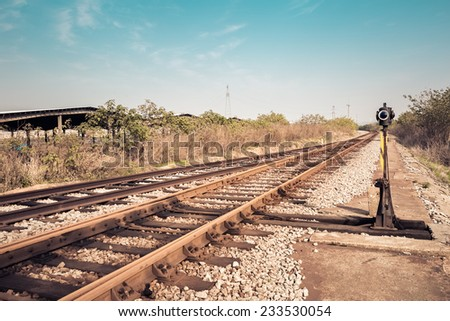 railroad landscape ,train line crossing in old factory's district   - stock photo